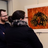 MGNE President, Daniel Embree, and Exhibitions Chair Becca Torres, look at a print by Rosetta Nesbitt.