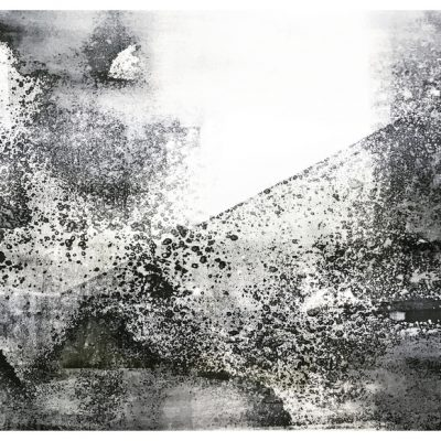 Abstract black and white landscape, with textured splattered black ink. Mountain in background with foggy clouds in foreground.